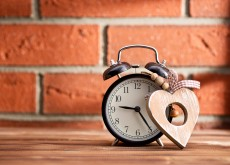wooden heart and alarm clock